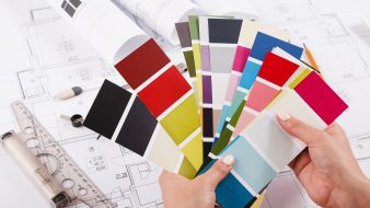 Interior designer working with color palette closeup. Architect choosing colors for building decoration, copy space